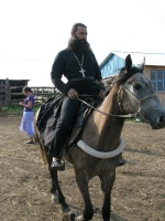 Батюшка на коне Сером